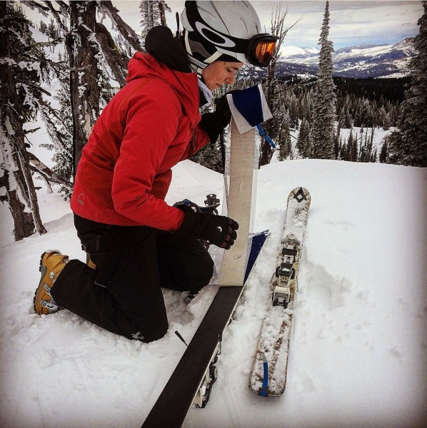 Putting on skins for some backcountry skiing