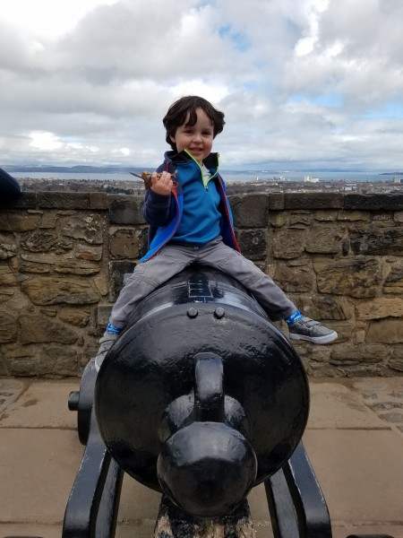 Tyler having fun at a castle in Edinburgh, Scotland