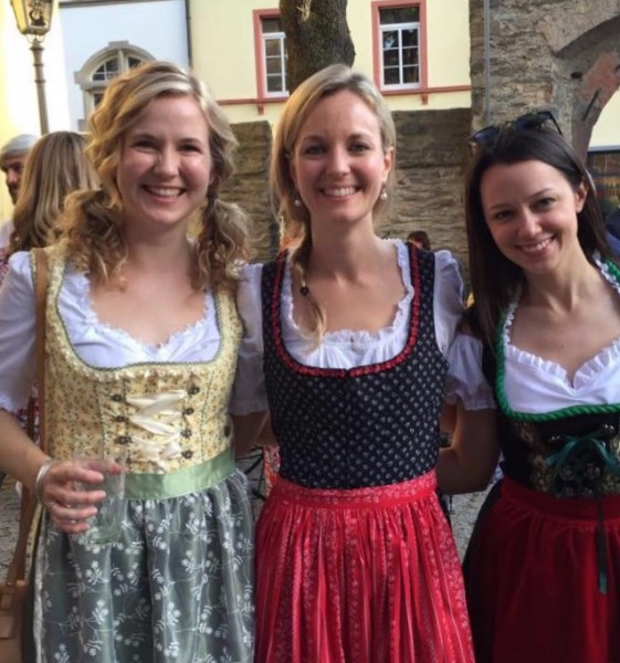 Rebecca with her two best high school friends, wearing dirndls at our rehearsal dinner