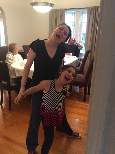 One of my favorite pictures of my niece and I just being silly singing and dancing!
