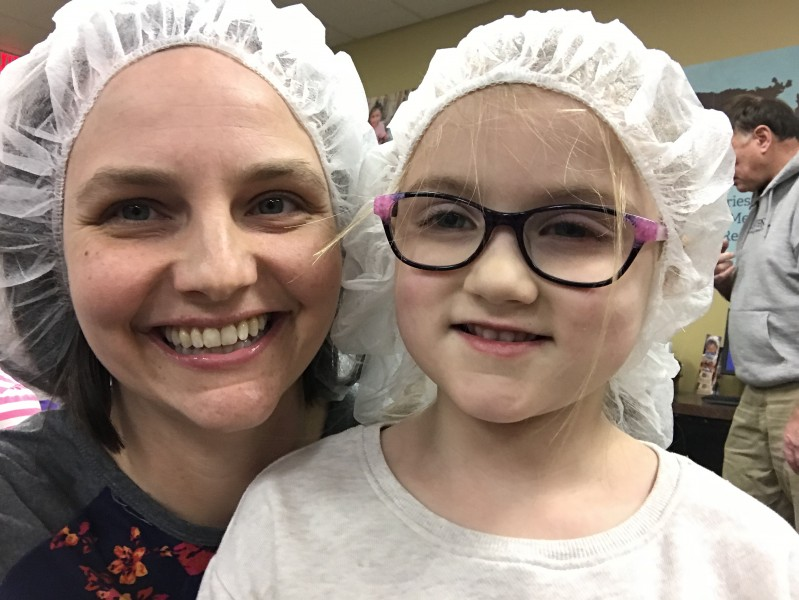 Showing the niece how to give back at Feed My Starving Children