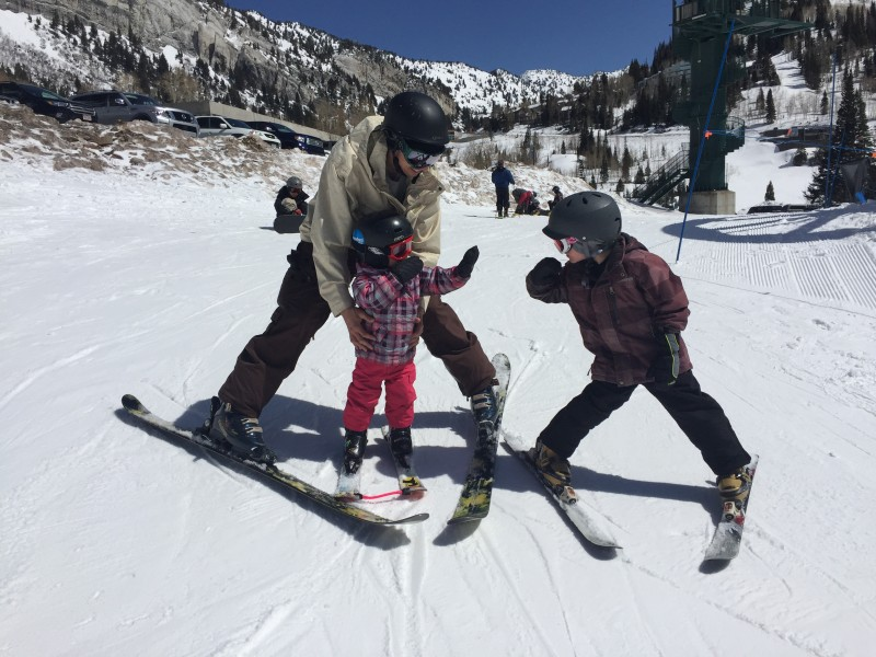 Carson giving Rocky a high five and encouraging her for her first time on skis.