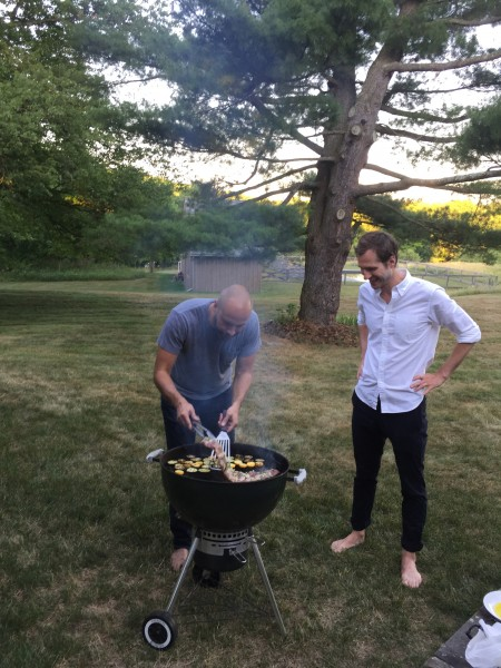 Jacques watching a friend prepare a BBQ