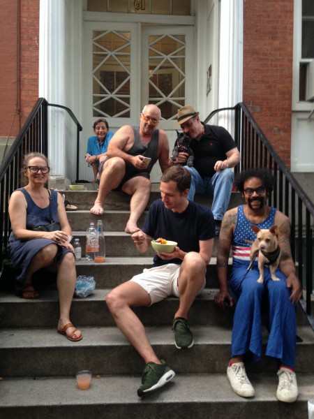 Jacques sitting on a stoop with friends in our NYC neighbourhood