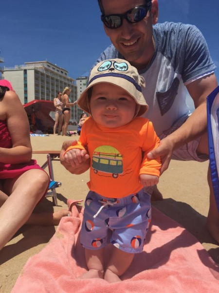 Baby's first time on a beach