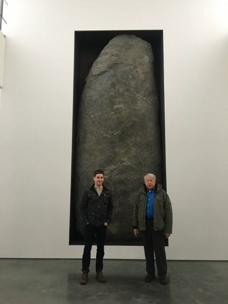 Family visit to a museum with a VERY large rock