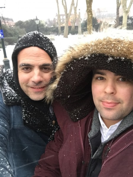 Walking through the snow together in London