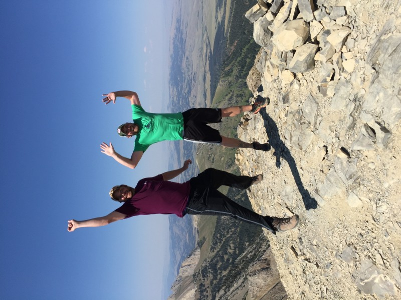 Kasey and his brother, Kenny, celebrating making it to the summit of the mountain.