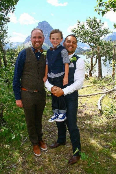 Holding our ring bearer and nephew, Huddy, before our wedding! He was so proud of his shoes!