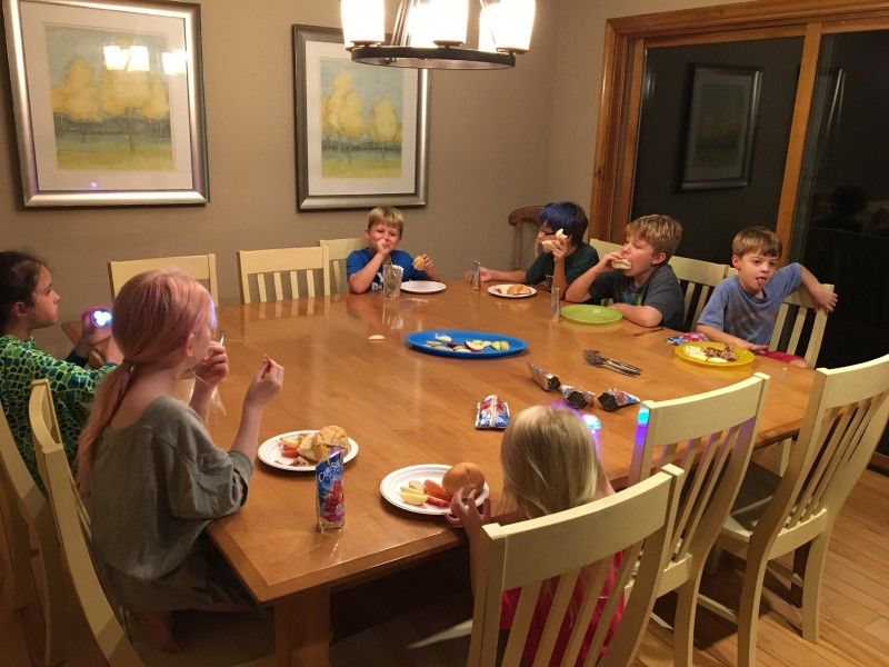 All the neighborhood kids having a big meal at our get-a-way house in the woods