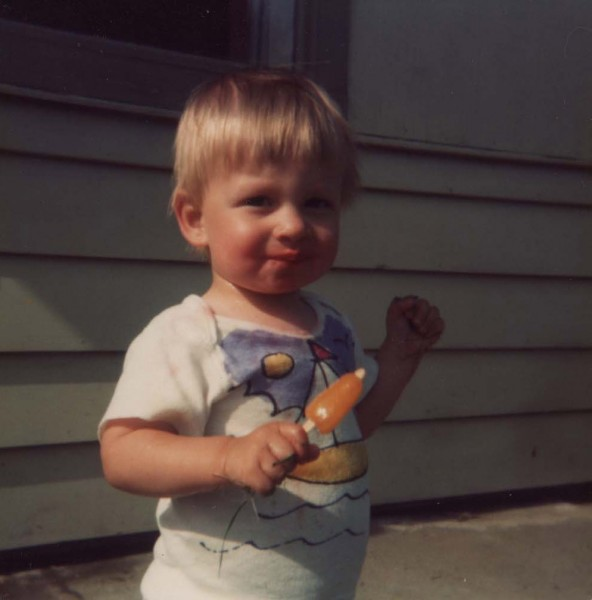 Alan as a cute baby eating a popsicle.