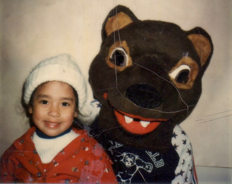 Kristina as a toddler with a scary looking bear!