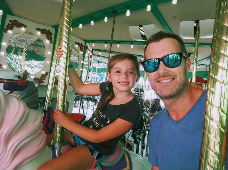 Niece and I on the merry-go-round at Busch Gardens