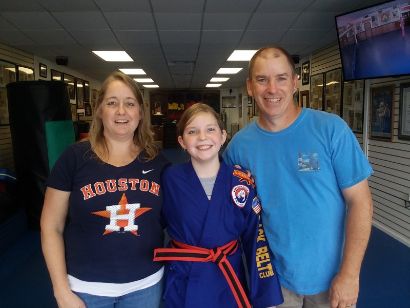 "Roo earning her ""Black Tip"" belt in Tae Kwon Do"