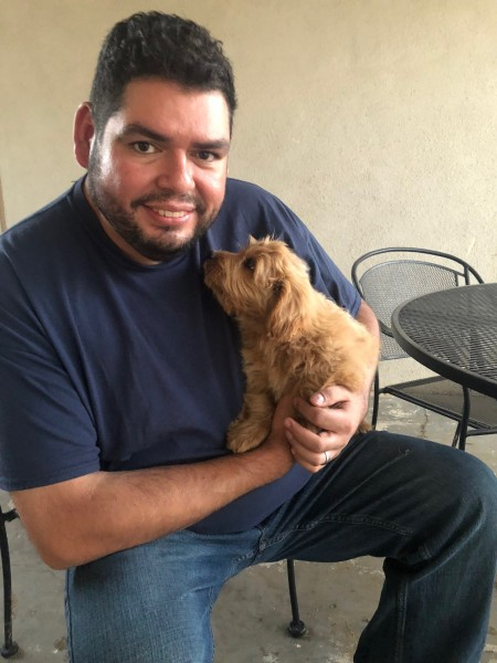 Marcos holding our new puppy Max.