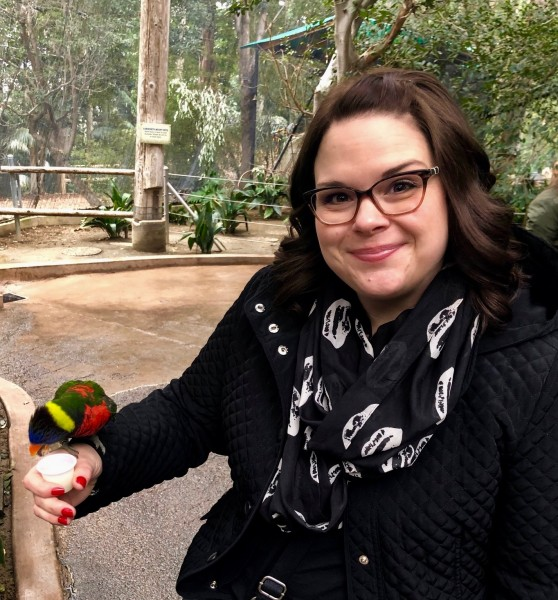 Stacey feeding the lorikeets.