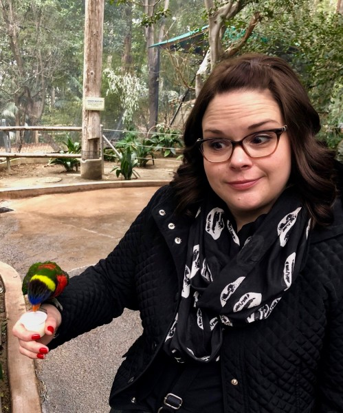 Stacey hoping the lorikeet does not bite her.