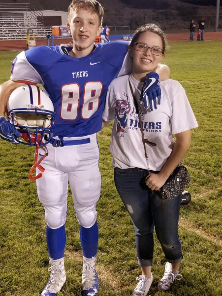 Football time! My son and daughter after this game. One proud mama