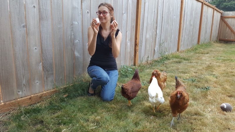 Marissa with our chickens' first eggs.