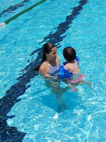 Kam teaching her cousin to swim