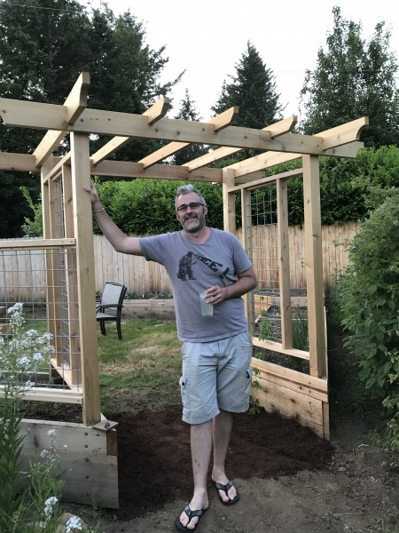 Reed finishes the garden beds and arbor!