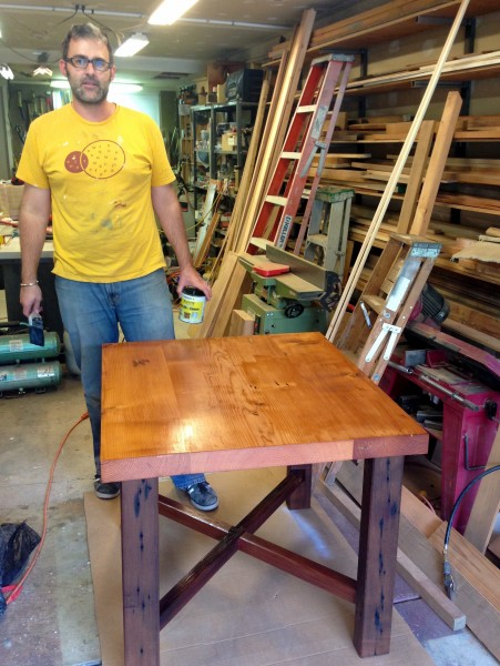 Reed working on a table in the shop