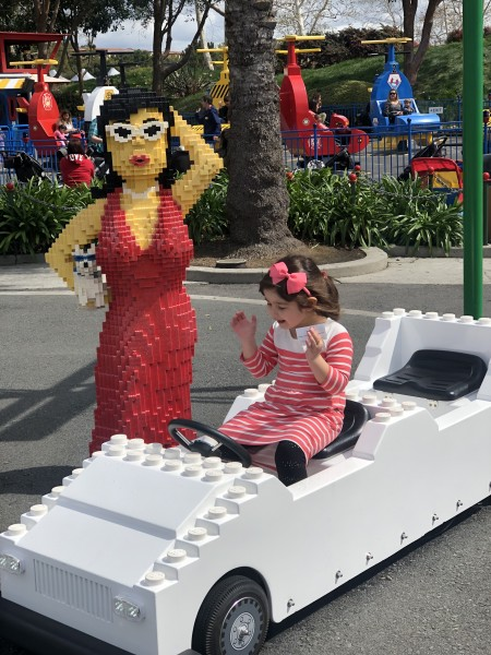 Legoland is full of fun things to for kids to sit in and let their imaginations go wild! Luna loves white cars for some reason.