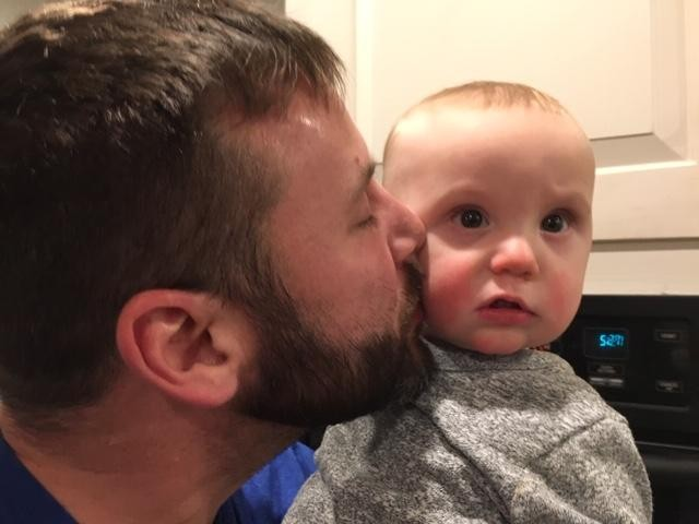 Hendrix gets a kiss from Daddy