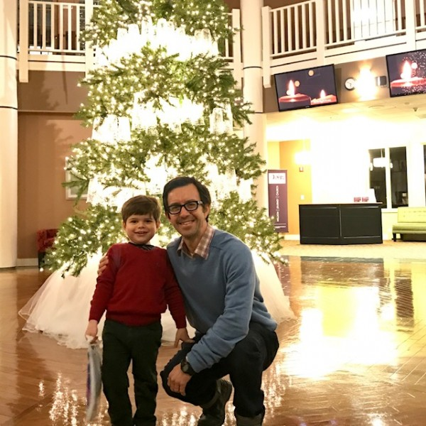 Eliot and Andrew in front of the Christmas tree at church