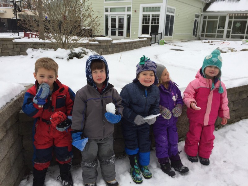 Eliot in the snow with his preschool buddies
