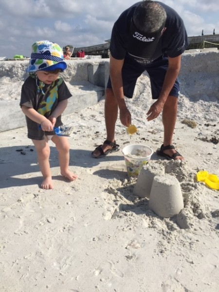 Eliot and papa building a sand castle in Bonita Springs, Florida