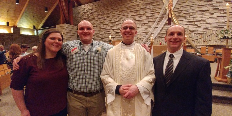 Brian's Confirmation at our Church.  This is us with Father Jim and his sponsor, Chad