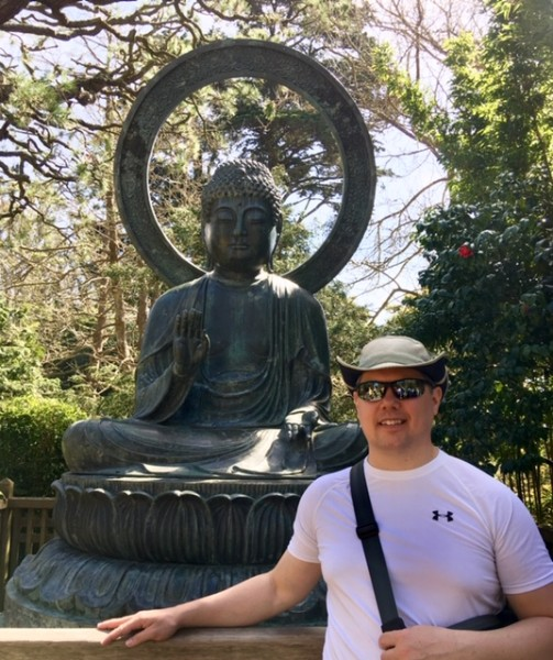 Jason with Buddha in San Francisco's Golden Gate Park