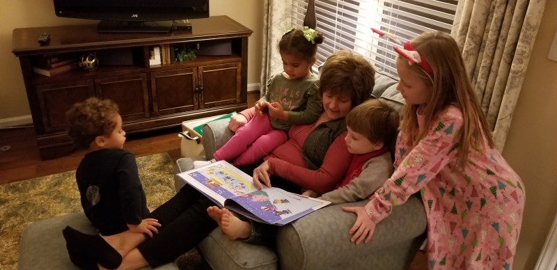 Oma reading to her grandchildren