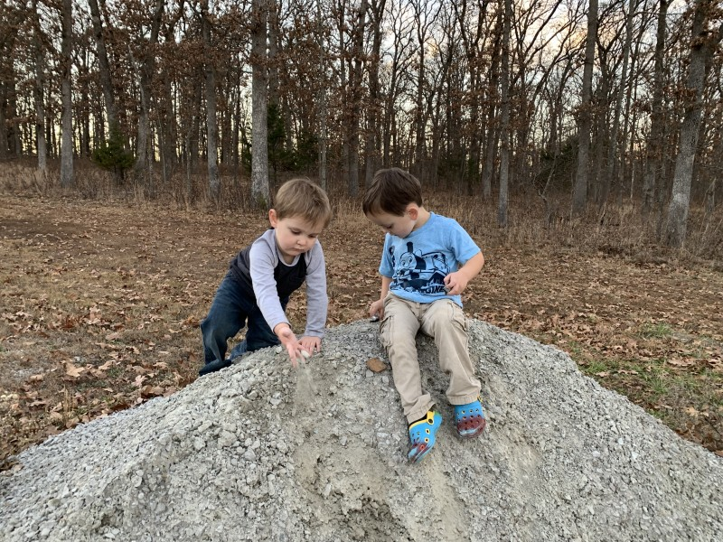 Parker had fun with his little cousin climbing on a rock pile.
