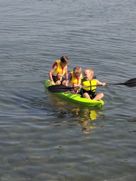 Laughing so much they kept falling off the kayak!