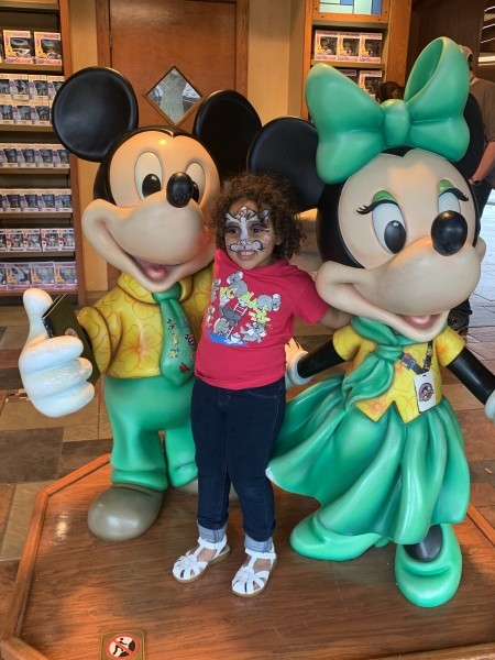 Posing with Mickey and Minnie