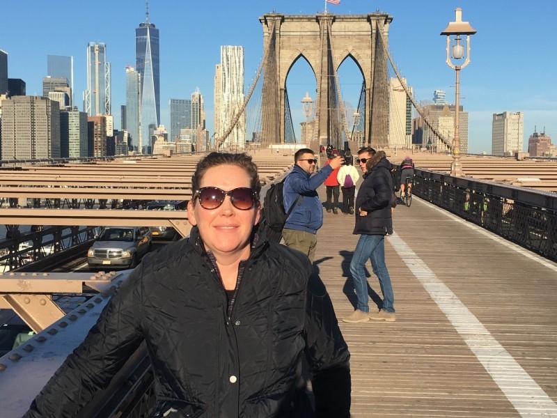Rachel walking the Brooklyn Bridge