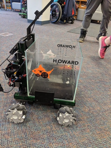The goldfish makes the robot move by swimming around