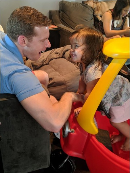 Brian and goddaughter play in toy car