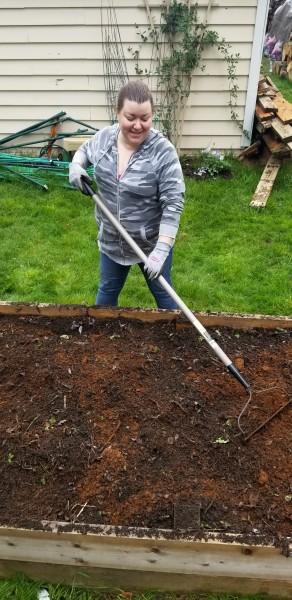 Odessa raking the soil