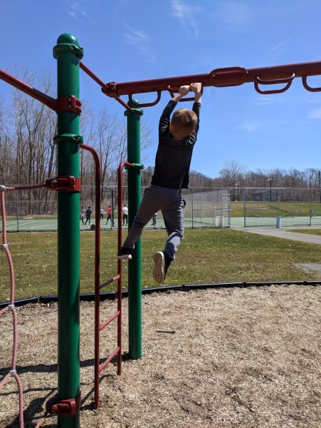 Mastering the monkey-bars!