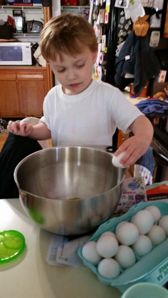 Cookie making helper! He loves cracking eggs
