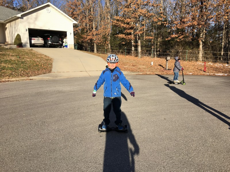 Our niece and nephew trying out their new hover board and scooter after Christmas.
