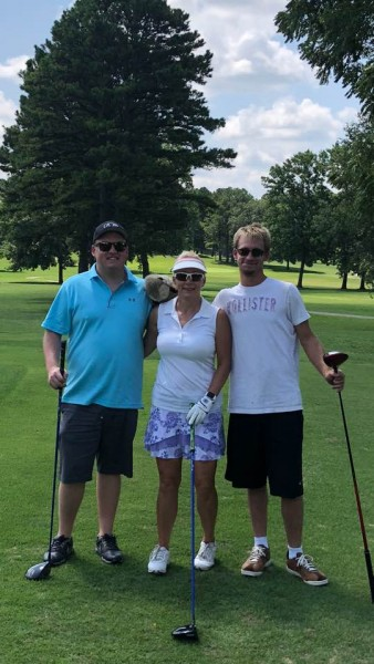 Fred and his mom and brother enjoying a game of golf on Mother's Day.