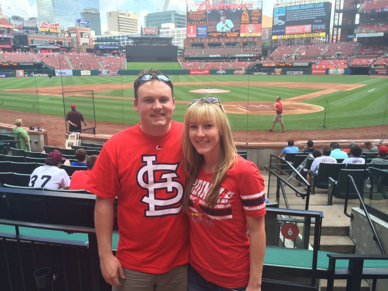 We love to watch baseball. Watching a game in STL.