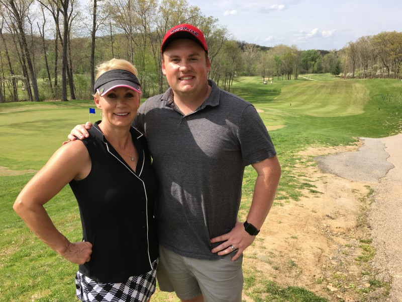 Fred and his mom before a game of golf.