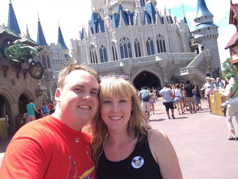 Us posing in front of the castle at Disney World.