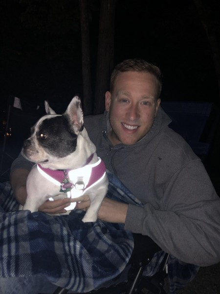 Joe and Zoey sitting by the campfire