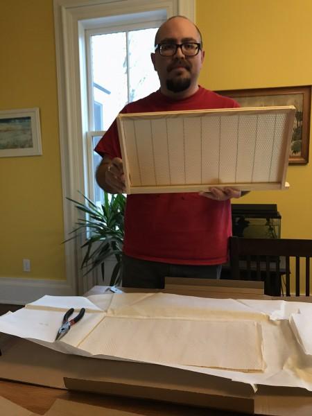 Roberto building bee hive frames.